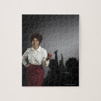 Studio portrait of female teacher with shadows puzzle