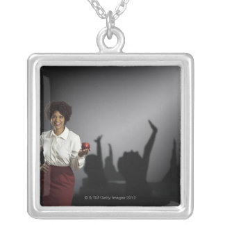 Studio portrait of female teacher with shadows silver plated necklace