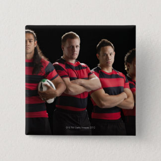 Studio portrait of male rugby team pinback button