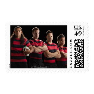 Studio portrait of male rugby team postage