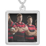 Studio portrait of male rugby team square pendant necklace