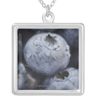 Studio shot of blueberries 2 square pendant necklace