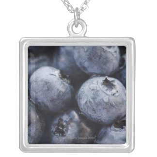 Studio shot of blueberries 3 square pendant necklace