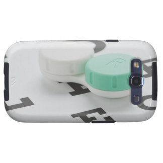 Studio shot of contact lens case on eye chart samsung galaxy SIII case