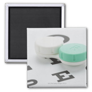 Studio shot of contact lens case on eye chart 2 inch square magnet