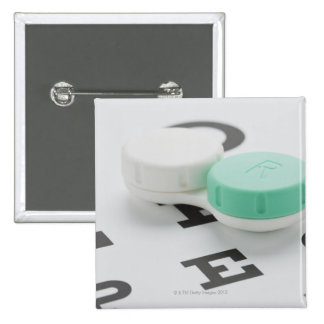 Studio shot of contact lens case on eye chart pins