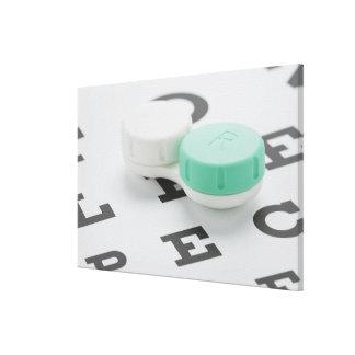 Studio shot of contact lens case on eye chart canvas print