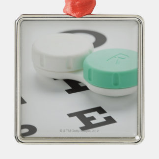 Studio shot of contact lens case on eye chart ornament