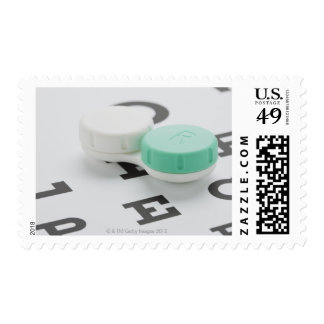 Studio shot of contact lens case on eye chart postage