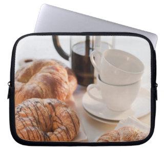 Studio shot of Croissants Laptop Sleeve