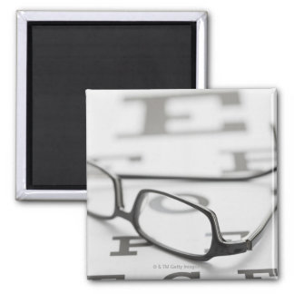 Studio shot of eyeglasses on eye chart 2 inch square magnet