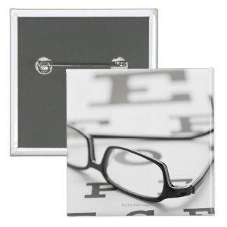 Studio shot of eyeglasses on eye chart button