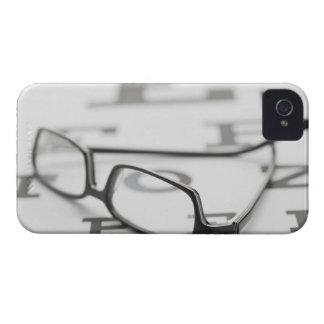 Studio shot of eyeglasses on eye chart iPhone 4 case