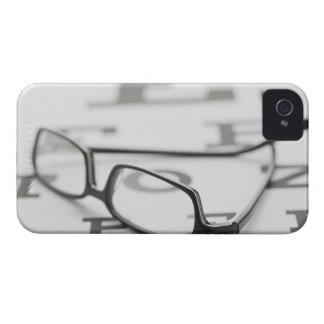 Studio shot of eyeglasses on eye chart iPhone 4 Case-Mate case