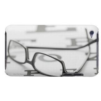 Studio shot of eyeglasses on eye chart iPod touch case