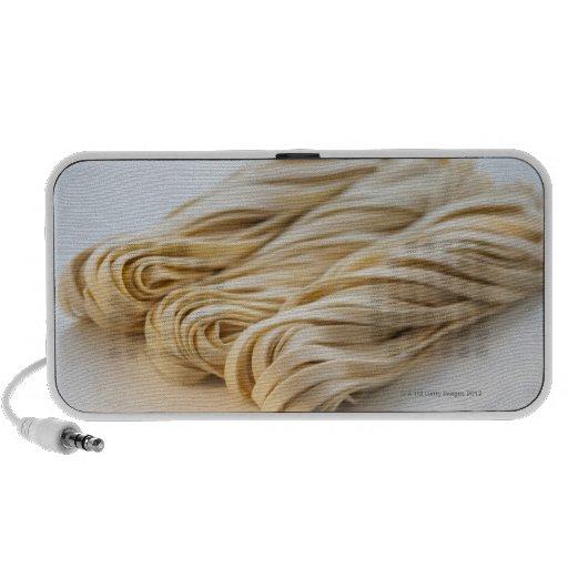 Studio shot of fresh linguini pasta mini speakers