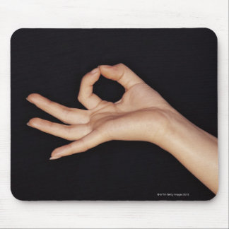 Studio shot of hand gesturing a sign mouse pad