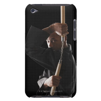 Studio shot of man exercising with nunchaku iPod touch case