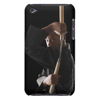 Studio shot of man exercising with nunchaku iPod touch cover