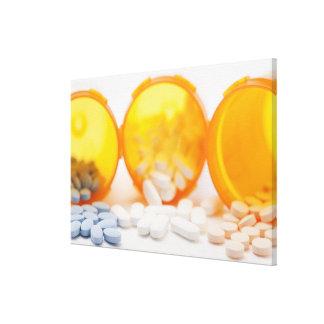 Studio shot of medicine bottle with pills canvas print