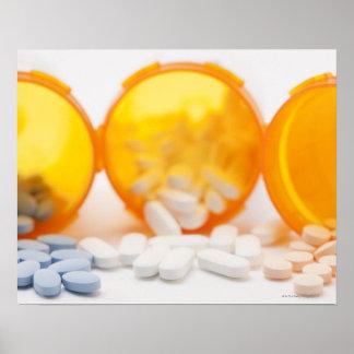 Studio shot of medicine bottle with pills poster
