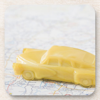 Studio shot of old-fashioned toy car drink coaster
