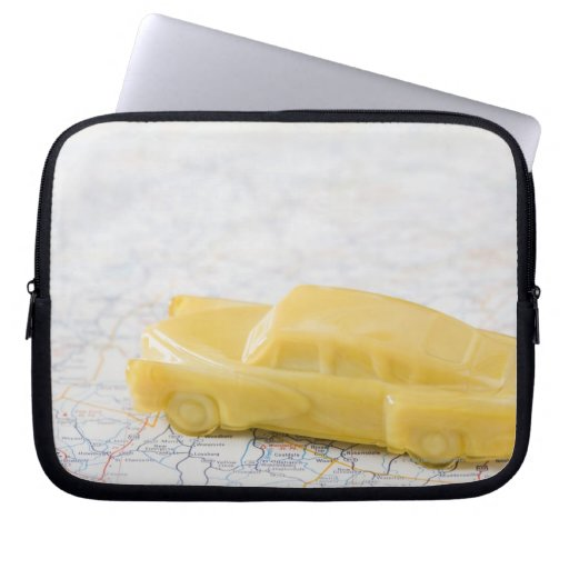 Studio shot of old-fashioned toy car laptop computer sleeves