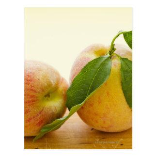 Studio shot of peaches postcard