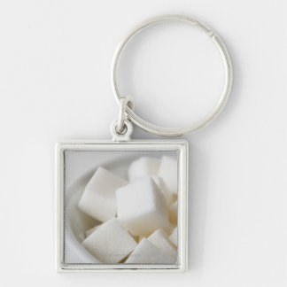 Studio shot of sugar cubes in bowl Silver-Colored square keychain