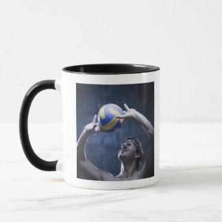 Studio shot of volleyball player playing mug