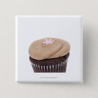 Studio still life shot of cupcakes. button