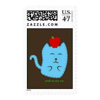 stuff on my cat - apple on head postage