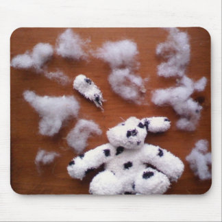 Stuffed dog brains mouse pad