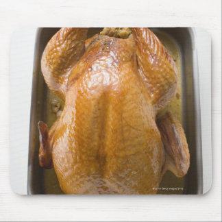 Stuffed roast turkey in roasting tray, close up mouse pad