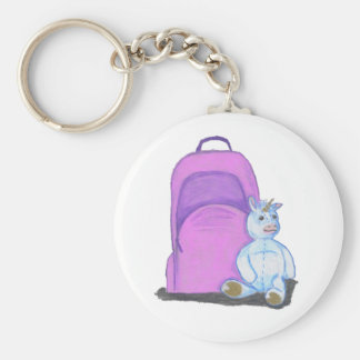 Stuffed Unicorn sits by a purple school Backpack Keychain