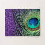 """Stunning Purple Peacock Jigsaw Puzzle<br><div class=""""desc"""">Beautiful peacock feather still life.  The soft glow of the photo brings out the stunning colors of the peacock feather.  A soft purple background is a perfect accent.</div>"""