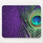 """Stunning Purple Peacock Mouse Pad<br><div class=""""desc"""">Beautiful peacock feather still life.  The soft glow of the photo brings out the stunning colors of the peacock feather.  A soft purple background is a perfect accent.</div>"""