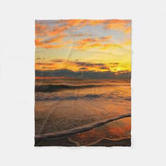 Stunning sunset on the beach fleece blanket