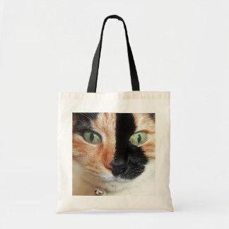 Stunning Tortoiseshell Cat with Vivid Green Eyes Tote Bag