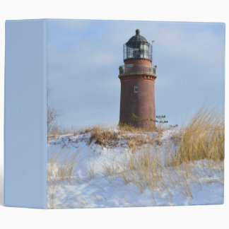Sturdy Lighthouse on a Rocky Coast in Winter 3 Ring Binders