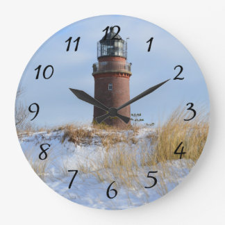 Sturdy Lighthouse on a Rocky Coast in Winter Large Clock
