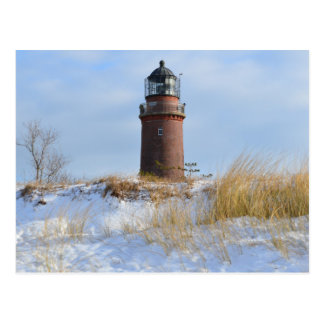 Sturdy Lighthouse on a Rocky Coast in Winter Post Card