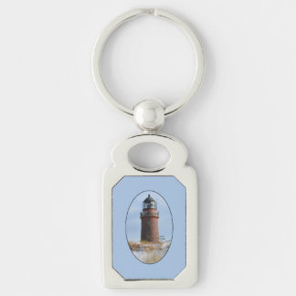 Sturdy Lighthouse on a Rocky Coast in Winter Silver-Colored Rectangular Metal Keychain