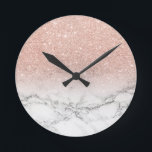 """Stylish faux rose pink glitter ombre white marble round clock<br><div class=""""desc"""">A cool,  trendy and stylish faux rose gold pink glitter ombre on modern white marble background. You can personalize it by adding your name or monogram</div>"""