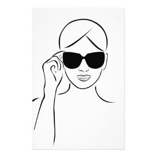 Stylish girl wearing shades stationery