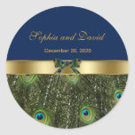 """Stylish Gold Blue Peacock Wedding Monogram Classic Round Sticker<br><div class=""""desc"""">Elegant Design featuring Peacock Feathers and navy blue background, separated by a golden ornament with a peacock ribbon for a special wedding event. It will give an unique touch to your wedding invitations. Be different! Personalize with your own information. If you need to move the text, or change the size,...</div>"""