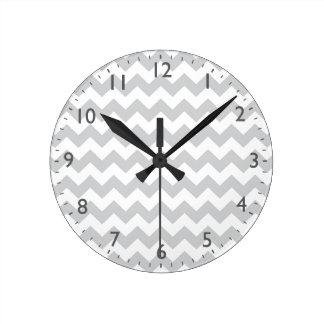 Stylish pale gray zig zags zigzag chevron pattern round clocks