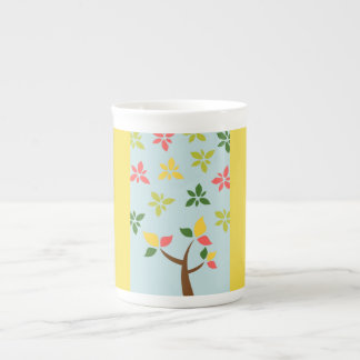 Stylized colorful tree and flowers tea cup
