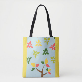 Stylized colorful tree and flowers tote bag