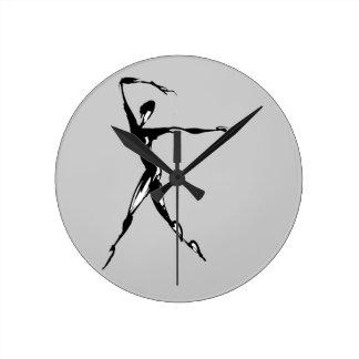 stylized dancing design round clock